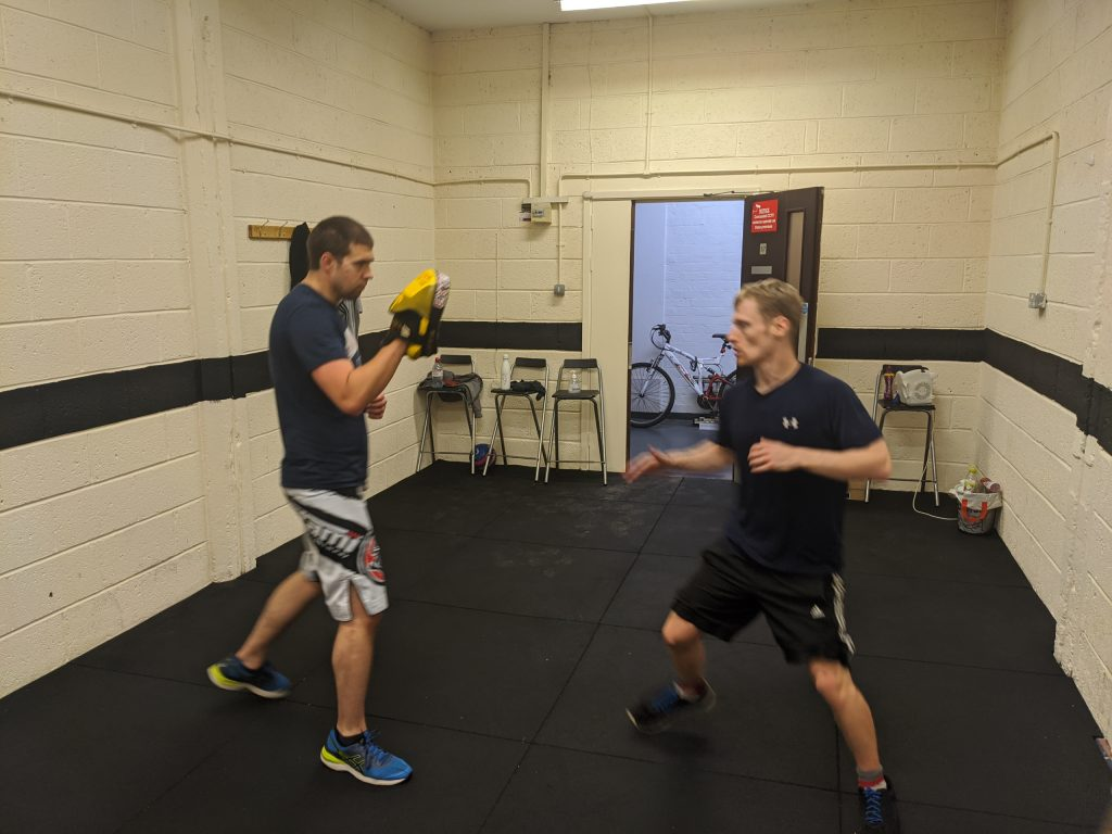 Martial arts classes near me with training drills on a focus pads for self defence training in hull